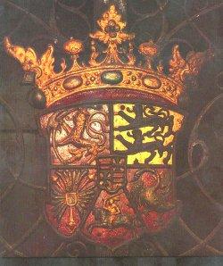 Wappen der Herzöge von Gottorf (aus der Zeit Friedrichs III). Es entspricht in seiner Zusammensetzung dem Titel des Herzogs: Erbe zu Norwegen [Löwe], Herzog zu Schleswig [zwei Löwen], Holstein [Nesselblatt], Stormarn [Schwan] und der Dithmarschen [Reiter], Graf zu Oldenburg und Delmenhorst [Herzschild mit Balken und Kreuz]