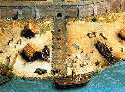 Rekonstruktion des Lübecker Hafens mit Stadtmauer um 1180: Die Stadtmauer ist schon massiv aus Backstein, jedoch noch ohne Türme